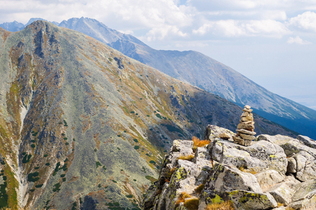 View of mountains from Solisko in High Tatras in Slovakia. Stacked zen style rocks in foreground