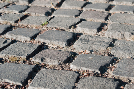 cobblestone road: Background image of old cobblestone road. Selective focus. Detail shot