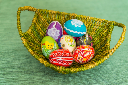 Beautiful colorful hand painted easter eggs in basket