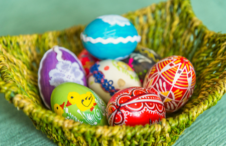 Beautiful colorful hand painted easter eggs in basket. Selective focus Stock Photo