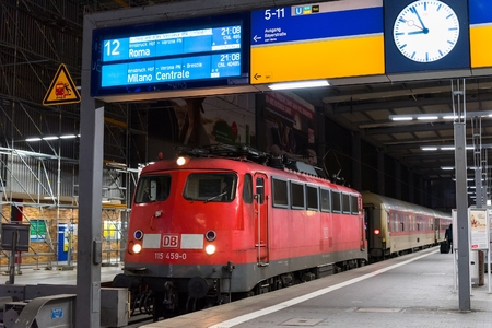 A commuter train waits at the Munich Main Railway Station (Hauptbahnhof). The train is part of Deutsche Bahns fleet, the German national railway company. MUNICH, GERMANY