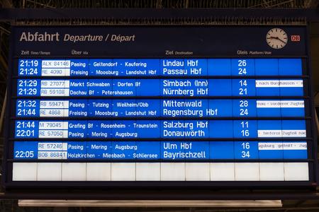 Train Departures timetable in Munchen Hauptbahnhof (Central Station) showing trains for Passau, Regensburg, Salzburg, Ulm and other German destinations. München, Germany Editorial