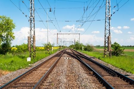 Two railway tracks in a rural scene Stock Photo