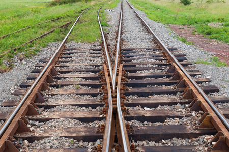 Railway tracks with railroad switch in a rural scene Stock Photo