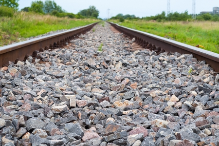 Detail of railway tracks with gravel. Selective focus Stock Photo
