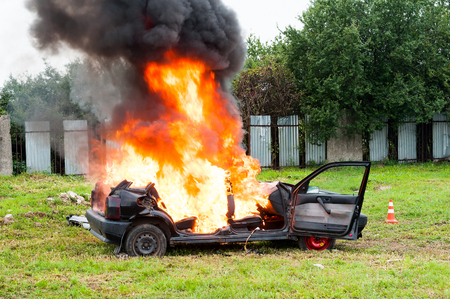 Burning car. Fire suddenly started engulfing all the car Stock Photo