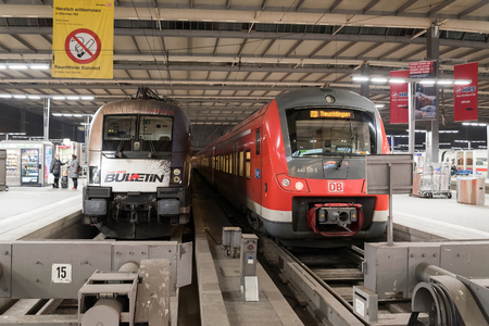 MUNICH, GERMANY - FEBRUARY 18, 2016: A commuter train waits at the Munich Main Railway Station (Munchen Hauptbahnhof). The train is part of Deutsche Bahn's fleet, the German national railway company.