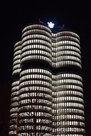 MUNICH, GERMANY - FEBRUARY 18, 2016: BMW Headquarters at night in Munich, Germany Stock Photo