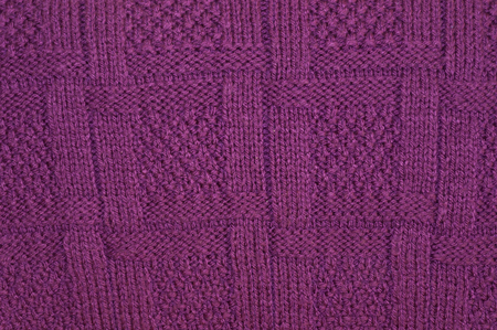 Background texture of knitted purple pullover