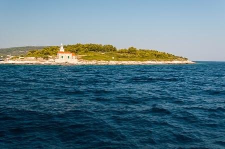 Lighthouse on the south end of island Hvar in the Adriatic sea. Sucuraj, Croatia