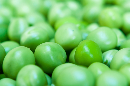 Background of fresh green peas. Selective focus. Macro shot Stock Photo
