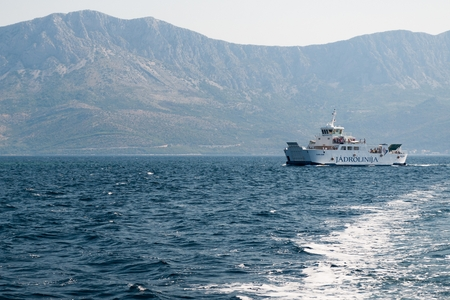 SUCURAJ, CROATIA - 18 JULY 2013: Ferry of company Jadrolinija near the island Hvar in Croatia. Mountain Biokovo in background. Editorial
