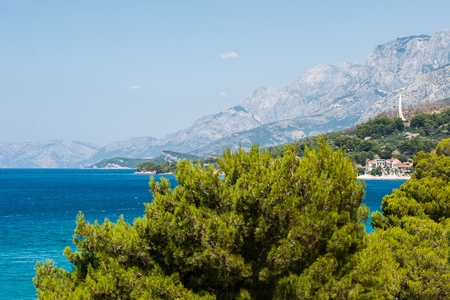 Adriatic sea at Podgora in Croatia with monument Seagull's wings and mountain Biokovo in background Stock Photo