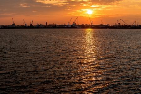 shipbuilding: Silhouette of sea port cranes in the morning at sunrise. Chioggia, Italy