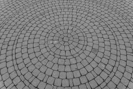 Background image of old cobblestone road in circle shape