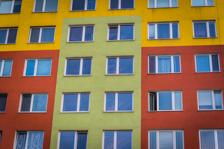 Colorful facade of high modern apartment building. Real estate background