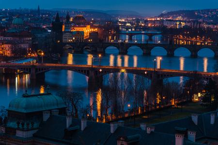 The Prague bridges with historic Charles Bridge and Vltava river in dusk at sunrise. Prague is a popular travel destination. Prague, Czech Republic
