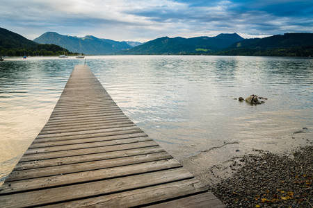 Picturesque view of wooden pier in the beach of Tegernsee lake near Gmund am Tegernsee in Germany Stock Photo