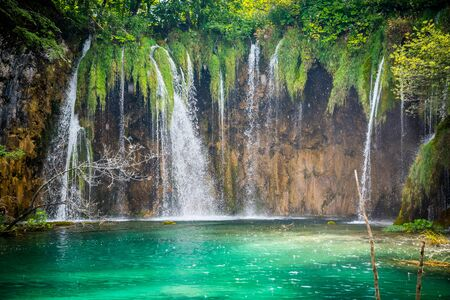 Amazing waterfalls with crystal clear water in the forest in Plitvice lakes National Park, Croatia. Nature landscape Stock Photo