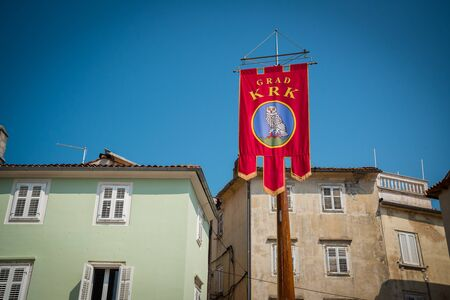 Coat of Arms in the Center Square of town Krk. Buildings in the background. Krk town is a famous touristic destination on Krk island, Croatia