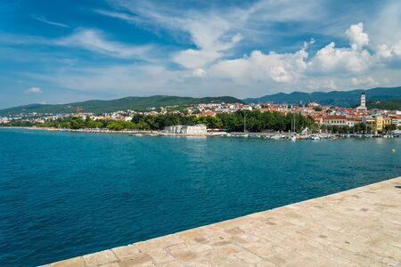 The quay of Crikvenica under blue sky. Crikvenica is a popular holiday resort in Kvarner riviera in Croatia