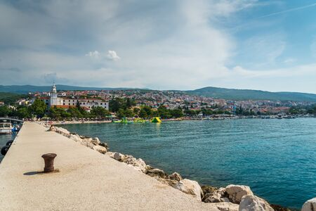The quay of Crikvenica with stones under blue sky. Crikvenica is a popular holiday resort in Kvarner riviera in Croatia