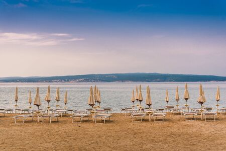 Sunshades on the empty beach of Crikvenica in the early morning. Crikvenica is a popular holiday resort in Croatia