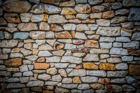 Stone wall background of colorful stones with HDR effect and vignetted borders Stock Photo - 145027106