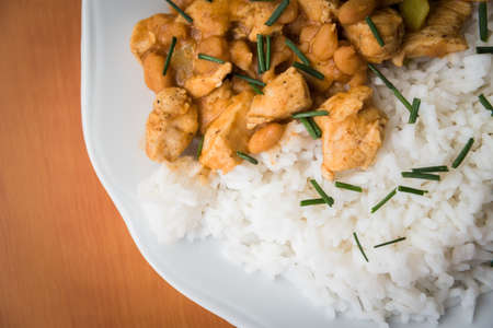 Chicken curry nuggets with rice and bean on a white plate Stock Photo