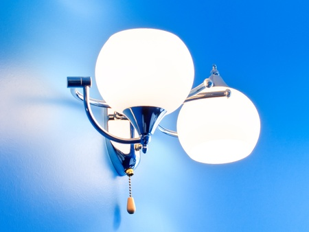 Lamp on textureized blue wall