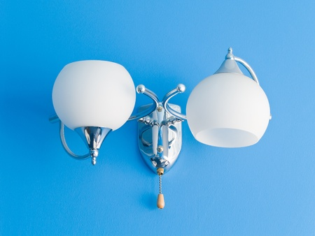 White lamp on blue texturized wall Stock Photo - 9087132