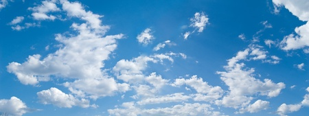 WIde sky panorama with white clouds Stock Photo