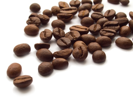 Roasted coffee beans on white background Stock Photo