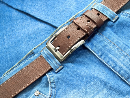 Blue jeans with leather belt Stock Photo