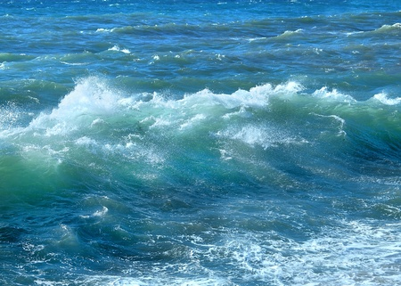 Blue ocean wave with sparkles and foam Stock Photo
