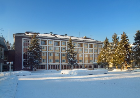 Hotel building with clear blue sky on winter day