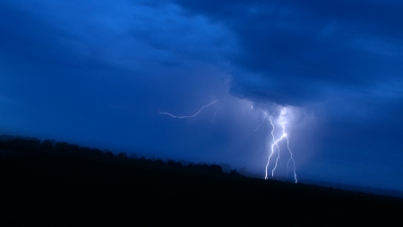 Great lightning in blue sky at night Stock Photo