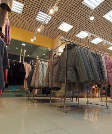 Retail shop with clothes for autumn season
