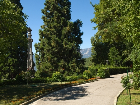 Path in subtropical park with column near Massandra Palace in Crimea