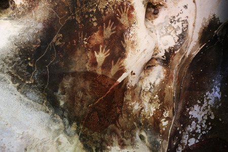 Sulawesi Cave Art with hand imprints, Indonesia. Stock Photo - 85882687