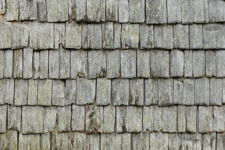 Traditional weathered wooden shingles close up texture.
