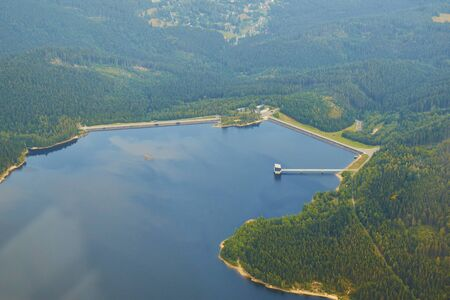 Aerial photo of water dam Josefuv dul surrounded by forests and hills Standard-Bild