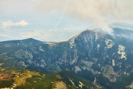 Summer aerial view of Snezka mountain summit in Krkonose mountains, Czechia / Poland.