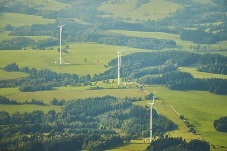 Aerial photo of beautiful landscape with meadows, forests and fields with wind turbines Standard-Bild