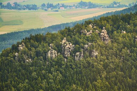 Aerial view of sandstone rock formations in Broumov Cliffs, Czechia.