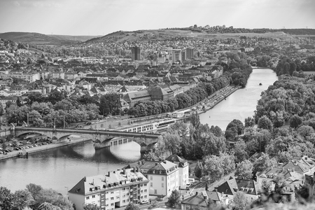 Main river, plants, old city in Wurzburg, Germany. Black and white photo