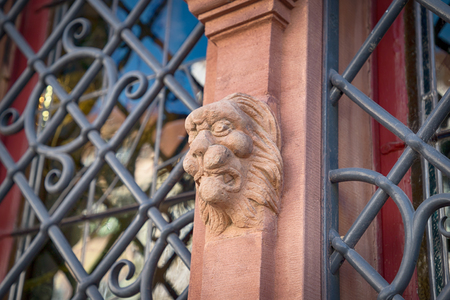 Old stone lions head. The house of heads. Details. Colmar, France Stock Photo