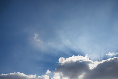 Beautiful blue sky with clouds and sun rays. Sky background