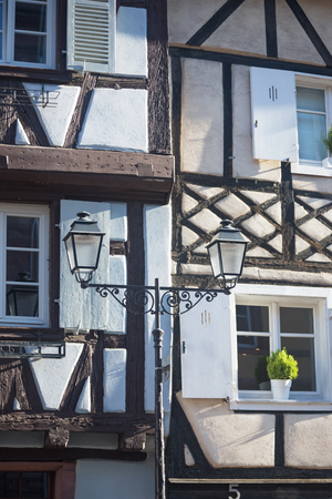 Half timbered house and street lantern. Fahverk. Details. Colmar town, Alsace France