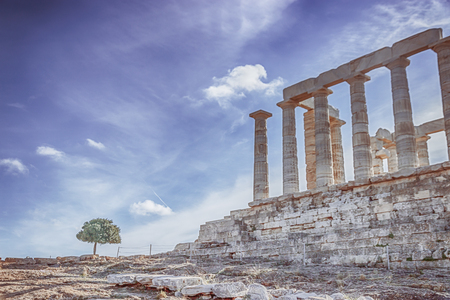 The Temple of Poseidon and a tree. Cape Sounion, Greece. soft focus, toned photo